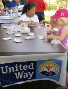 The summer program reaches ages pre-K to elders with free programming. Pictured here, United Way funded and led a literacy fun fair for parents and their preschoolers this summer.