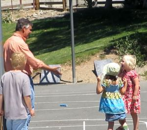 Jim Barcellos of UNCE congratulates a youngster for her successful rocket launch