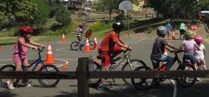 Kids learned road rules and safety and received new bike helmets during a bike rodeo with Western Safe Routes to School.