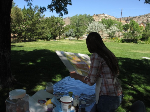 girl painting in park