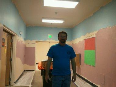 mr duran art teacher on mural project